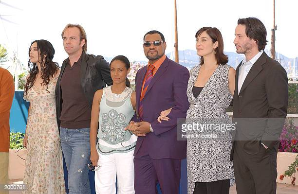 Actors Monica Bellucci Hugo Weaving Jada Pinkett Smith Laurence Fishburne CarrieAnne Moss and Keanu Reeves pose at a photocall for the film The...