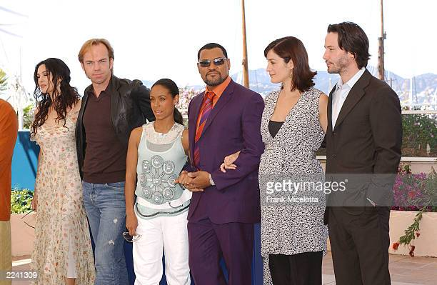 Actors Monica Bellucci Hugo Weaving Jada Pinkett Smith Laurence Fishburne CarrieAnne Moss and Keanu Reeves pose at a photocall for the film Matrix...