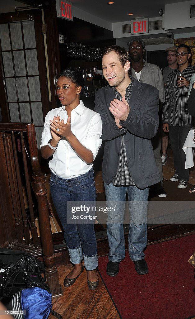 Actors Montego Glover and Chad Kimball attend the 'Memphis' cast portrait unveiling at Tony's di Napoli on September 23, 2010 in New York City.