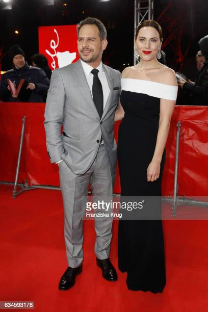 Actors Moritz Bleibtreu and Antje Traue attend the 'Bye Bye Germany' premiere during the 67th Berlinale International Film Festival Berlin at...
