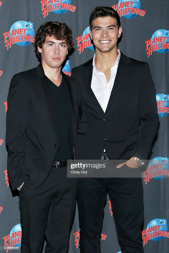 Actors Munro Chambers and Luke Bilyk visit Planet Hollywood Times Square on July 16, 2013 in New York City.