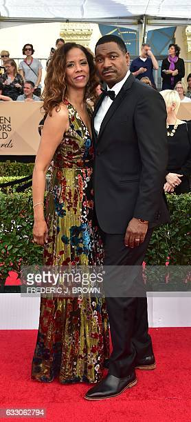 Actors Mykelti Williamson and Sondra Spriggs arrive for the 23rd Annual Screen Actors Guild Awards at the Shrine Exposition Center on January 29 in...