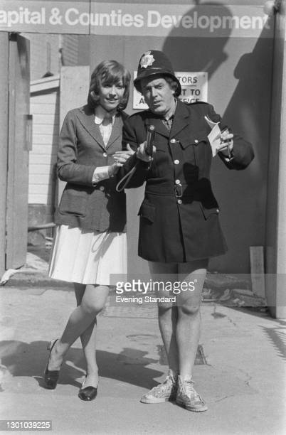 Actors Myra Frances and Brian Rix, stars of the British comedy film 'Don't Just Lie There, Say Something!', UK, 17th May 1973. Rix is dressed as a...