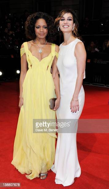 Actors Naomie Harris and Berenice Marlohe arrive at the Orange British Academy Film Awards 2012 at The Royal Opera House on February 12 2012 in...