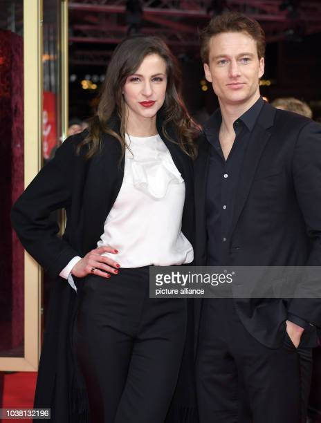 Actors Natalia Belitski and Alexander Fehling arrive for the premire of the movie 'In Zeiten abnehmenden Lichts' at the 67th International Berlin...