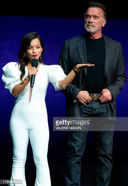 Actors Natalia Reyes and Arnold Schwarzenegger speak on stage during the CinemaCon Paramount Pictures Exclusive Presentation at the Colosseum Caesars...