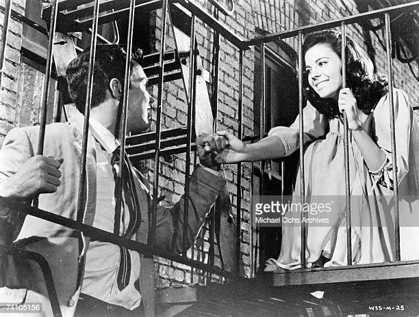 Actors Natalie Wood actor Richard Beymer perform balcony scene in 1961 film West Side Story directed by Jerome Robbins and Robert Wise West Side...