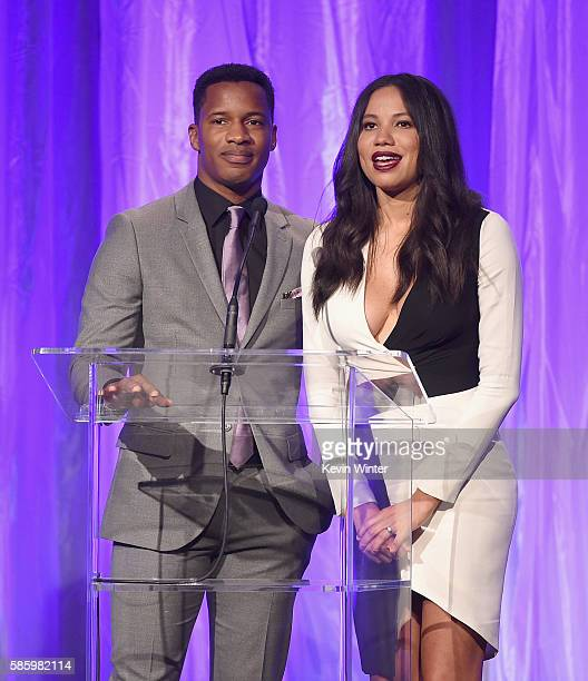 Actors Nate Parker and Jurnee SmollettBell speak onstage at the Hollywood Foreign Press Association's Grants Banquet at the Beverly Wilshire Four...