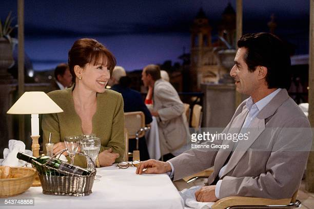 """Actors Nathalie Baye and Sami Frey on the set of """"La Voix"""" , directed by Pierre Granier-Deferre and based on a short story """"La Voix"""" written by the..."""