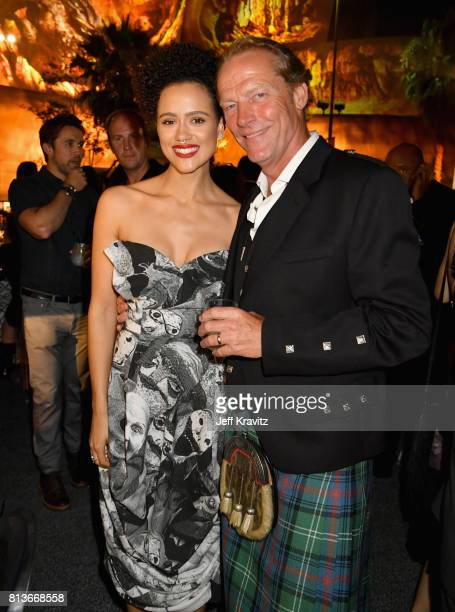 """Actors Nathalie Emmanuel and Iain Glen at the Los Angeles Premiere for the seventh season of HBO's """"Game Of Thrones"""" at Walt Disney Concert Hall on..."""