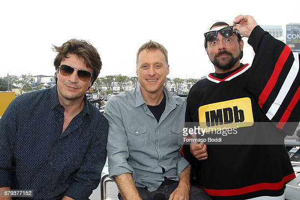 Actors Nathan Fillion Alan Tudyk and host Kevin Smith attend the IMDb Yacht at San Diego ComicCon 2016 Day Three at The IMDb Yacht on July 23 2016 in...