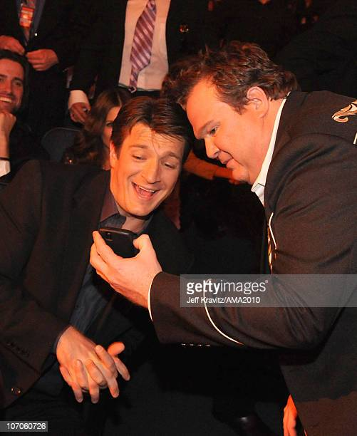 Actors Nathan Fillion and Eric Stonestreet attend the 2010 American Music Awards at Nokia Theatre LA Live on November 21 2010 in Los Angeles...