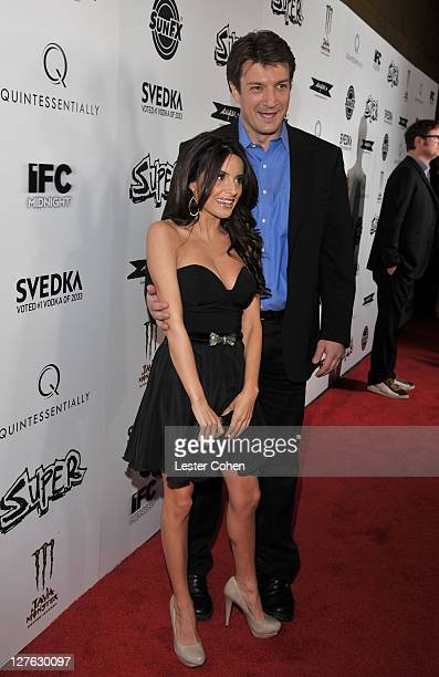 Actors Nathan Fillion and Mikaela Hoover arrive at the Los Angeles premiere of Super at the Egyptian Theatre on March 21 2011 in Hollywood California