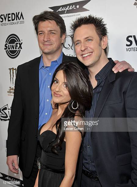 Actors Nathan Fillion Mikaela Hoover and Writer/director James Gunn arrive at the Los Angeles premiere of Super at the Egyptian Theatre on March 21...