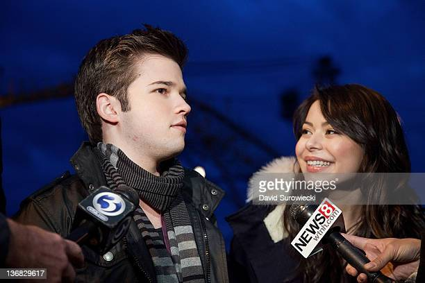 Actors Nathan Kress and Miranda Cosgrove talk to the press at Naval Submarine Base New London on January 11 2012 in Groton Connecticut The cast of...