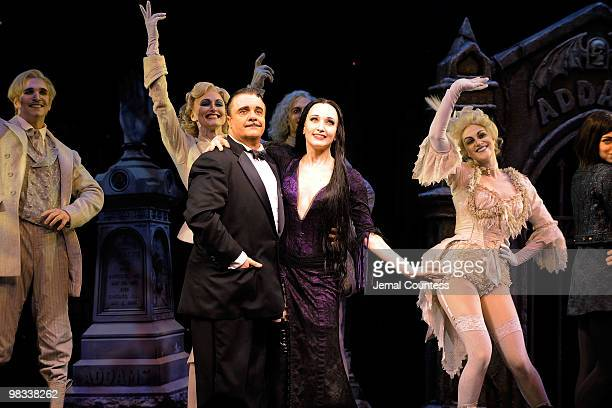 Actors Nathan Lane and Bebe Neuwirth join the cast of 'The Adams Family' as they take a bow following the opening night of the Broadway production of...
