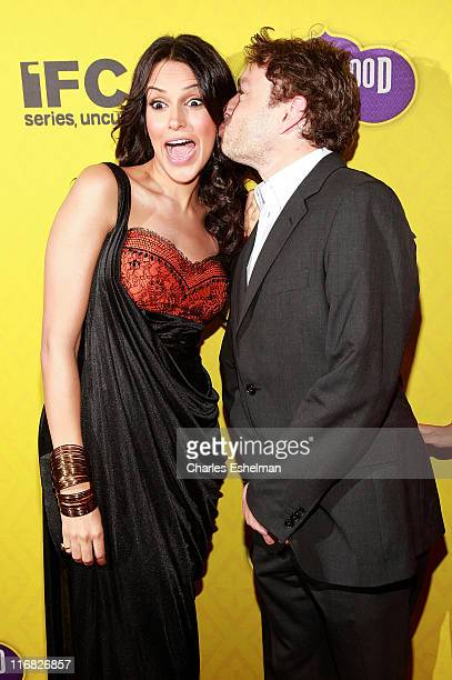 Actors Neha Dhupia and Chris Kattan attend a screening of 'Bollywood Hero' at the Rubin Museum of Art on August 4 2009 in New York City