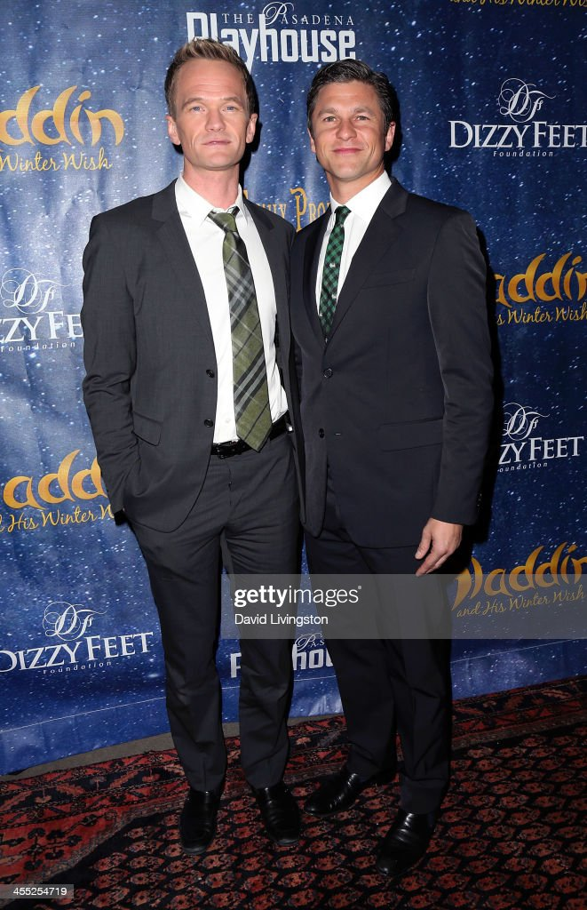 Actors Neil Patrick Harris (L) and David Burtka attend 'Aladdin and His Winter Wish' opening night at the Pasadena Playhouse on December 11, 2013 in Pasadena, California.