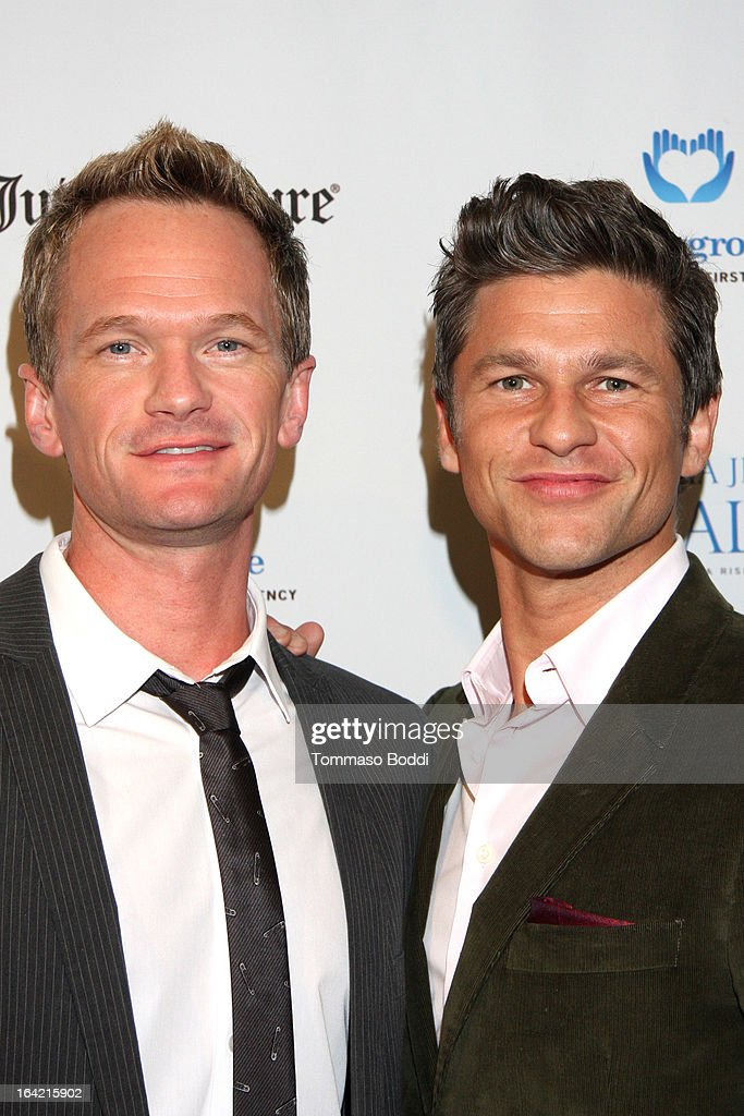 Actors Neil Patrick Harris (L) and David Burtka attend the 1st Annual Norma Jean Gala held at the TCL Chinese Theatre on March 20, 2013 in Hollywood, California.