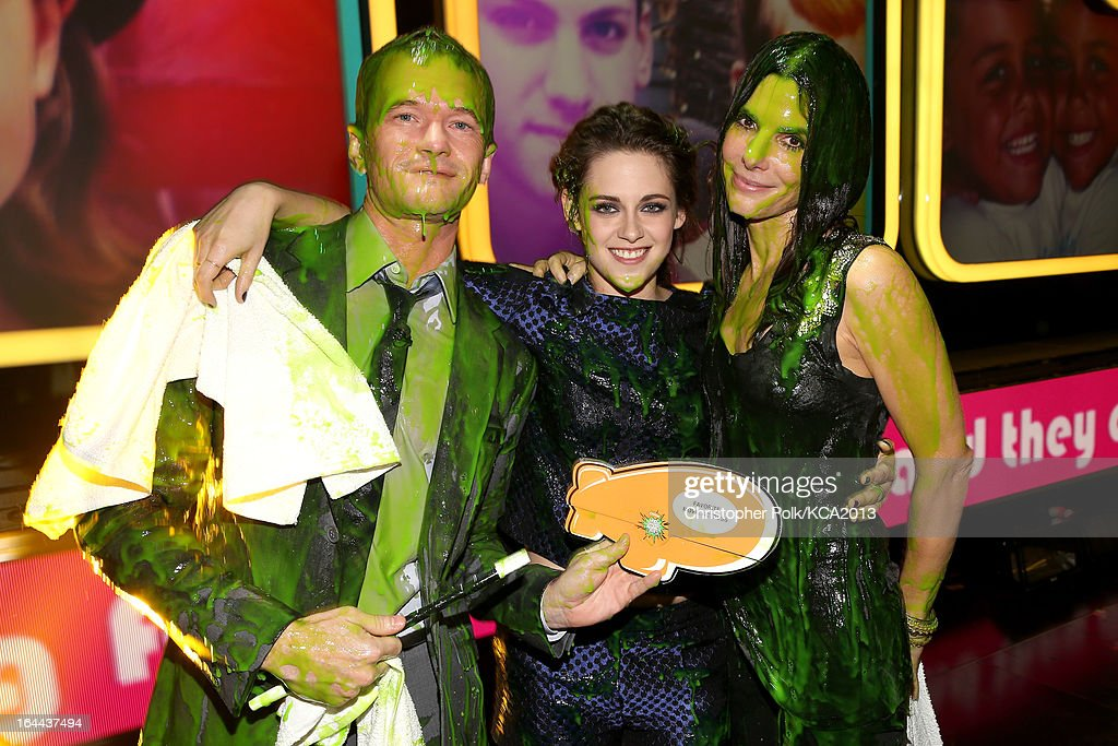 Actors Neil Patrick Harris, Kristen Stewart, and Sandra Bullock seen backstage at Nickelodeon's 26th Annual Kids' Choice Awards at USC Galen Center on March 23, 2013 in Los Angeles, California.