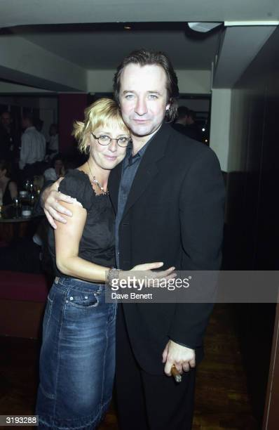 Actors Neil Pearson and Emma Chambers pose at the afterparty for the first night of 'Benefactors' on June 26 2002 at Theatros London