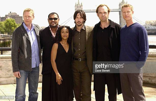 Actors Neil Rayment Laurence Fishburne Jada PinkettSmith Keanu Reeves Hugo Weaving and Adrian Rayment attend 'The Matrix Reloaded' photocall at...