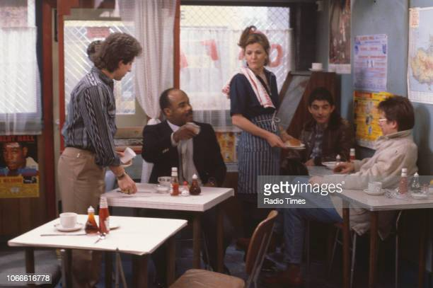 Actors Nejdet Salih Oscar James Sandy Ratcliff John Altman and Tom Watt in a scene from the BBC soap opera 'EastEnders' December 14th 1984