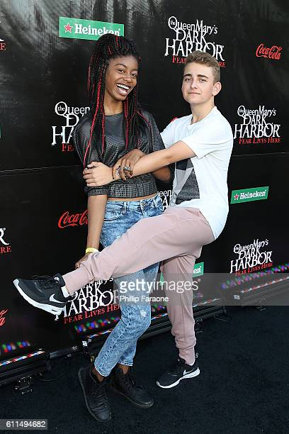 Actors Nia Imani and Buddy Handleson attend The Queen Mary's Dark Harbor 2016 at Queen Mary Beach on September 29 2016 in Long Beach California