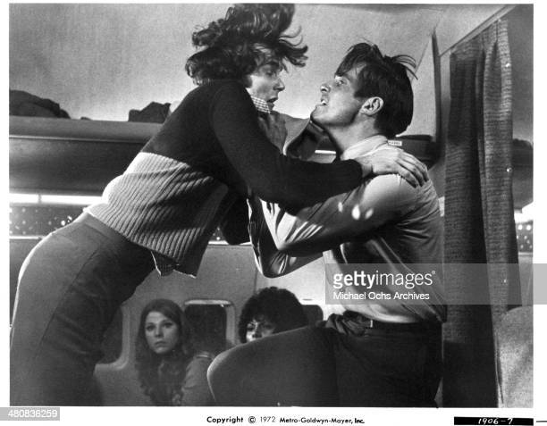 Actors Nicholas Hammond and James Brolin fight in a scene from the movie Skyjacked circa 1972