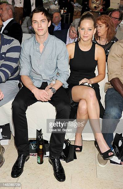 Actors Nicholas Hoult and Jennifer Lawrence attend a cocktail reception during Amber Lounge Fashion Monaco 2012 at Le Meridien Beach Plaza Hotel on...