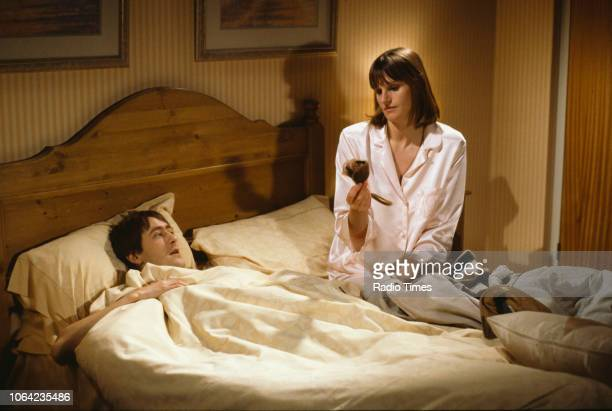 Actors Nicholas Lyndhurst and Gwyneth Strong in a bedroom scene from episode 'Three Men a Woman and a Baby' of the BBC Television sitcom 'Only Fools...