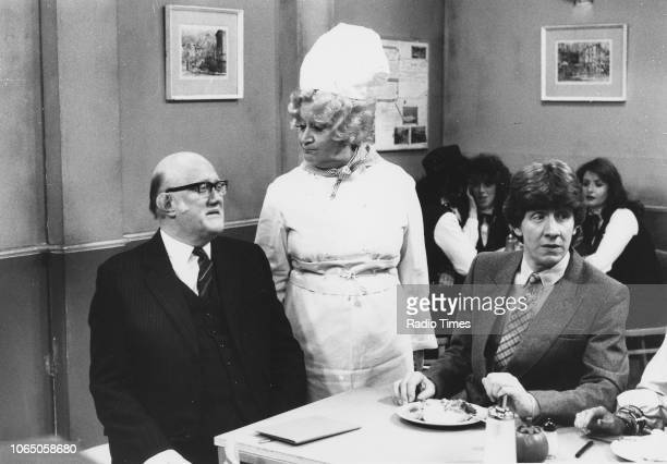 Actors Nicholas Smith Mollie Sugden and Mike Berry in a scene from episode 'Goodbye Mrs Slocombe' of the television sitcom 'Are You Being Served'...