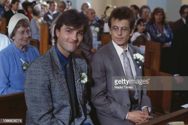 Actors Nick Berry and Tom Watt pictured on a church set during filming for the BBC soap opera 'EastEnders' December 30th 1984