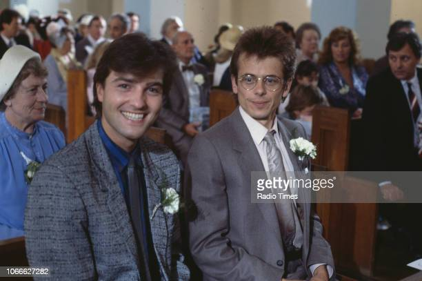 Actors Nick Berry and Tom Watt pictured on a church set during filming for the BBC soap opera 'EastEnders' 1986