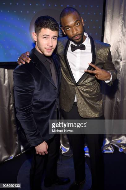 Actors Nick Jonas and Jay Pharoah attend Moet Chandon celebrate The 23rd Annual Critics' Choice Awards at Barker Hangar on January 11 2018 in Santa...