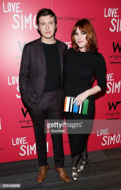 "Actors Nick Robinson and Molly Ringwald pose for a photo at the screening of ""Love, Simon"" hosted by 20th Century Fox & Wingman at The Landmark at 57..."