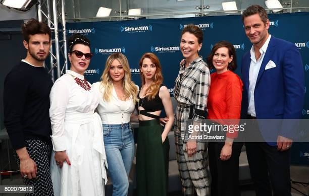 Actors Nico Tortorella Debi Mazar Hilary Duff Molly Bernard Sutton Foster Miriam Shor and Peter Hermann from the cast of YOUNGER pose for photos...