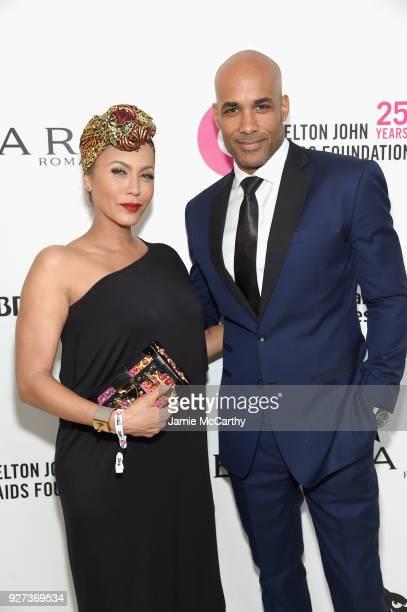 Actors Nicole Ari Parker and Boris Kodjoe attends the 26th annual Elton John AIDS Foundation Academy Awards Viewing Party sponsored by Bulgari...
