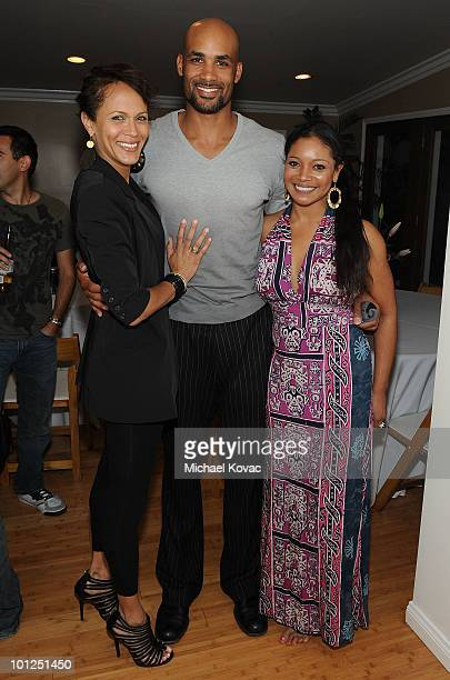 """Actors Nicole Ari Parker and husband Boris Kodjoe and Tamala Jones attend the """"35 And Ticking"""" Film Wrap Party on May 28, 2010 in Woodland Hills,..."""