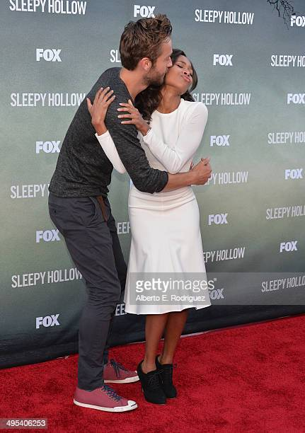 Actors Nicole Beharie and Tom Mison arrive to a special screening of Fox's 'Sleepy Hollow' at Hollywood Forever on June 2 2014 in Hollywood California