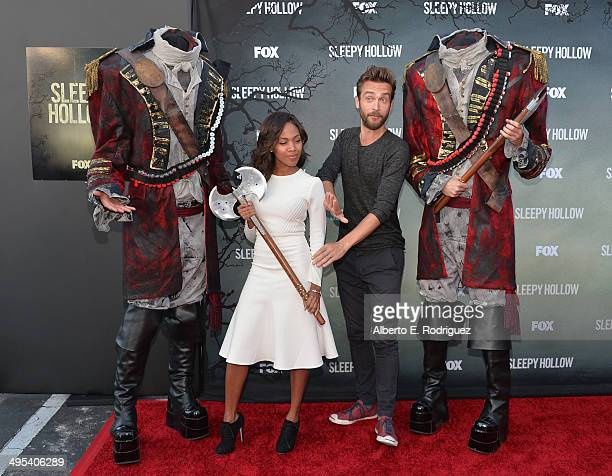 Actors Nicole Beharie and Tom Mison pose wtih headless horsemen at a special screening of Fox's Sleepy Hollow at Hollywood Forever on June 2 2014 in...