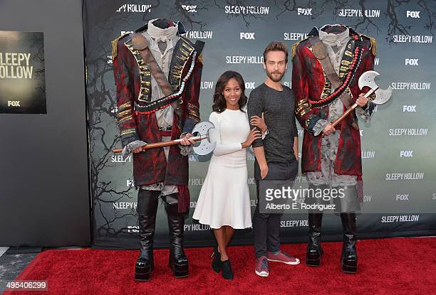 Actors Nicole Beharie and Tom Mison pose wtih headless horsemen at a special screening of Fox's 'Sleepy Hollow' at Hollywood Forever on June 2 2014...