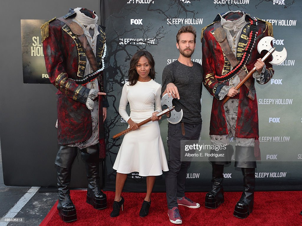 Actors Nicole Beharie and Tom Mison pose wtih headless horsemen at a special screening of Fox's 'Sleepy Hollow' at Hollywood Forever on June 2, 2014 in Hollywood, California.
