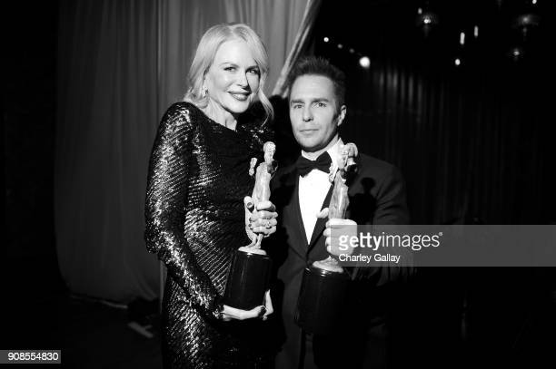 Actors Nicole Kidman and Sam Rockwell pose backstage with awards for Outstanding Performance by a Female Actor in a Miniseries or Television Movie...