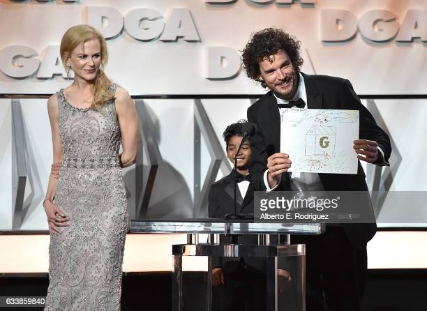"""Actors Nicole Kidman and Sunny Pawar present the Feature Film Nomination Plaque for """"Lion"""" to director Garth Davis onstage during the 69th Annual..."""