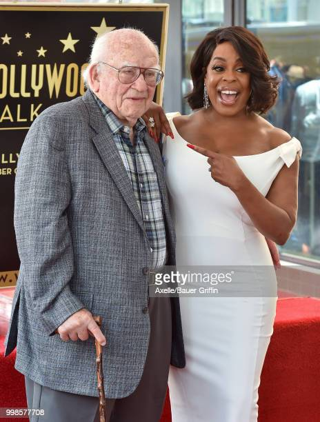 Actors Niecy Nash and Ed Asner attend the ceremony honoring Niecy Nash with star on the Hollywood Walk of Fame on July 11 2018 in Hollywood California