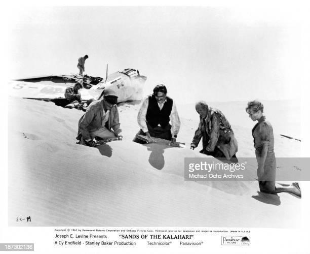 Actors Nigel Davenport Stuart WhitmanStanley Baker Harry Andrews and actress Susannah York on set of Paramount Pictures movie Sands of the Kalahari...