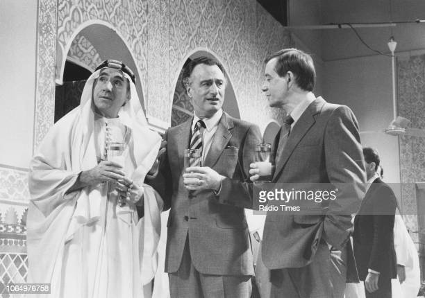 Actors Nigel Hawthorne Paul Eddington and Derek Fowlds in a scene from episode 'The Moral Dimension' of the television sitcom 'Yes Minister' November...