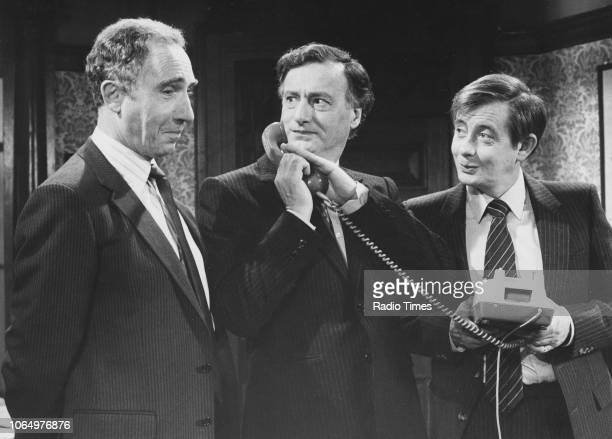 Actors Nigel Hawthorne Paul Eddington and Derek Fowlds in a scene from the television sitcom 'Yes Minister' 1981