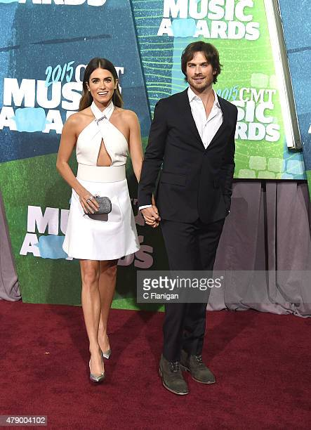 Actors Nikki Reed and Ian Somerhalder attend the 2015 CMT Music awards at the Bridgestone Arena on June 10, 2015 in Nashville, Tennessee.